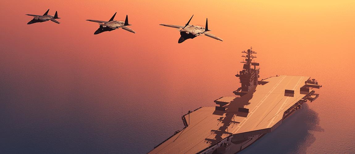 Avions de chasse au dessus d'une plate forme d'atterrissage en mer