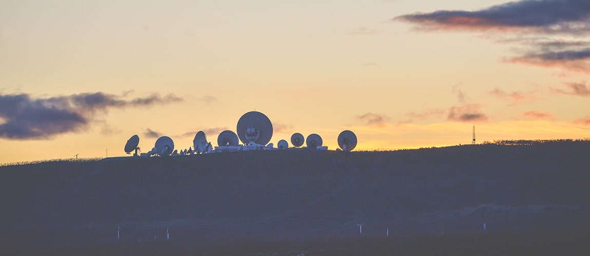 A Silhouette Of Satellites When Sun Set In Country Side.