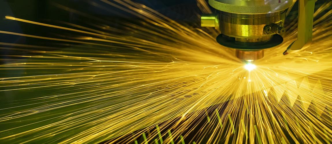 The CNC Fiber Laser Cutting Machine Cutting The Metal Plate With